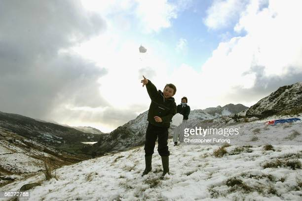 Children enjoy a day off school sledging as they take to the hills and mountains of Snowdonia after the first major snow fall of winter on November...