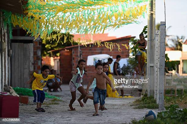 Children enjoy a game of football at the Serviluz Favela on June 10 2014 in Fortaleza Brazil
