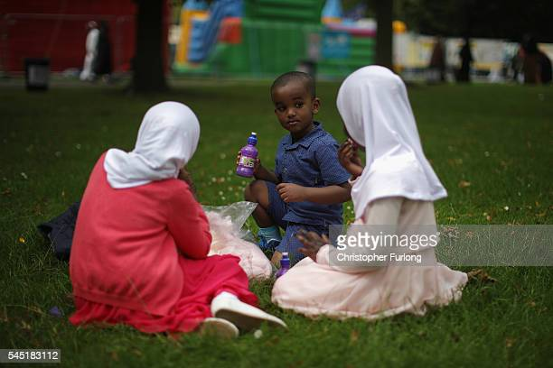Children enjoy a picnic as they celebrate the festival of Eid in Small Heath Park on July 6 2016 in Birmingham England Up to 70000 people congregated...