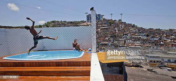 Children enjoy a pool after the police raided the house of the chief drug dealer of the Morro do Alemao shantytown on November 28 2010 in Rio de...