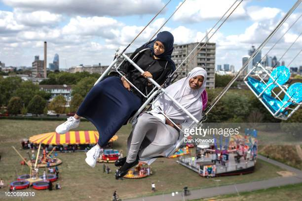 Children enjoy a ride during an Eid in the Park celebration marking the start of Eid AlAdha at Burgess Park on August 21 2018 in London England The...