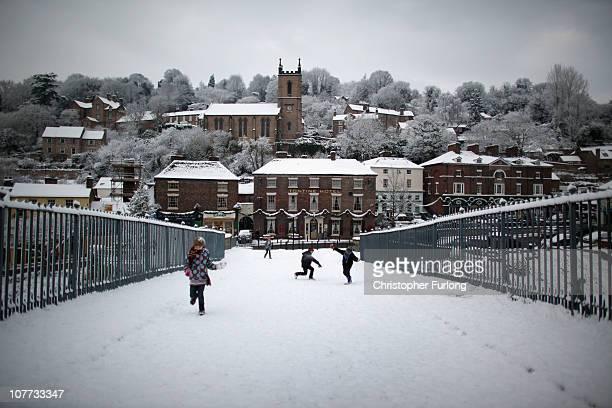 Children enjoy a snow ball fight on the iron bridge of the Ironbridge World Heritage Site on December 22 2010 in Ironbridge United Kingdom The...
