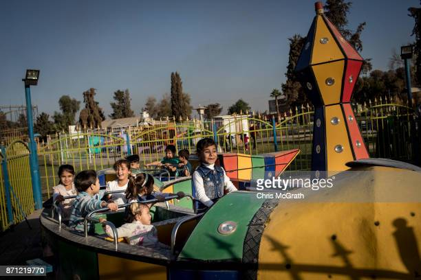 Children enjoy a train ride at the Mosul Amusement Park on November 4 2017 in Mosul Iraq The theme park was shut down under ISIS occupation and the...
