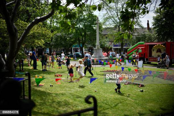 Children enjoy circus games as people attend a Great Get Together event in memory of murdered MP Jo Cox on June 17 2017 in Heckmondwike England More...