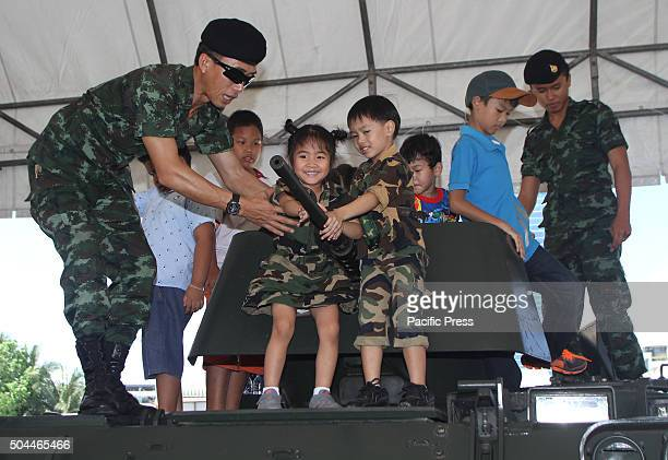 Children enjoy guns during the National Children's Day at the Horse Brigade Bangkok Weapons such as tanks troop transport artillery guns helicopter...