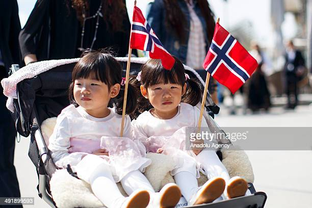 Children enjoy Norwegian Constitution Day celebrations on May 17 2014 in Oslo Norway Norway's Constitution declaring the country to be an independent...