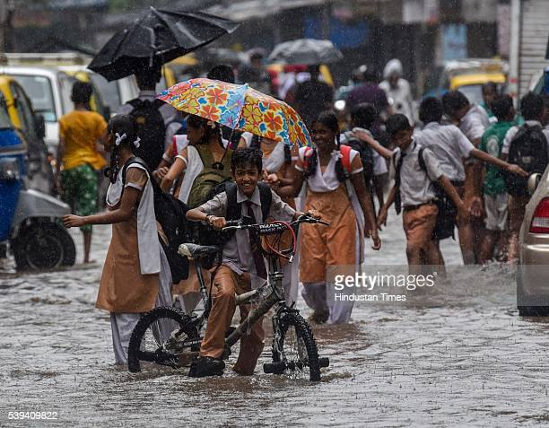 Children enjoy raindrops during premonsoon showers at Vile Parle on June 11 2016 in Mumbai India Mumbai rains have finally commenced on Saturday...