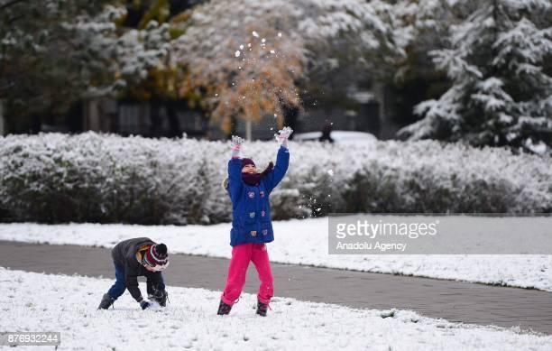 Children enjoy season's first snowfall in Usak, Turkey on November 21, 2017. Snow depth reaches 3 centimeters in town center and 10 centimeters in...