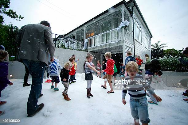 Children enjoy the ice and the snow machine outside a house on Franklin Road in Ponsonby on December 1 2015 in Auckland New Zealand It is the 22nd...