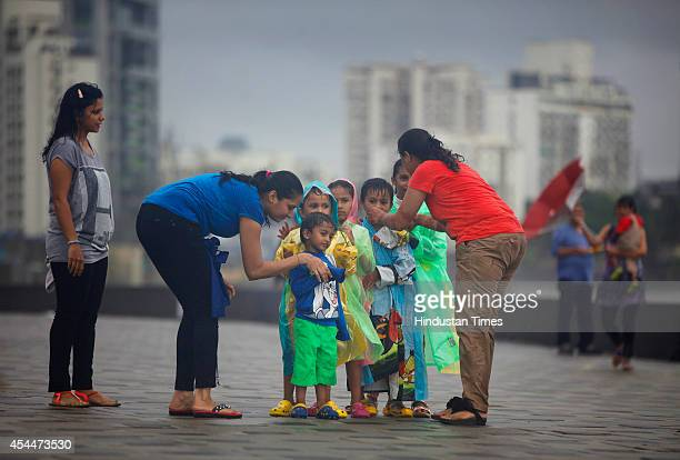 Children enjoy the monsoon at Worli on September 1 2014 in Mumbai India With heavy rains lashing the city for second consecutive day the MeT...