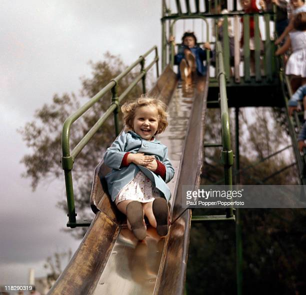 Children enjoying a slide in a playground in Fleetwood circa 1950