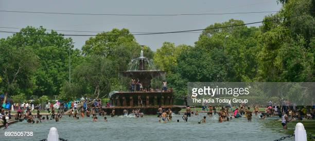 Children enjoying at India Gate water pond during a hot weather in New Delhi