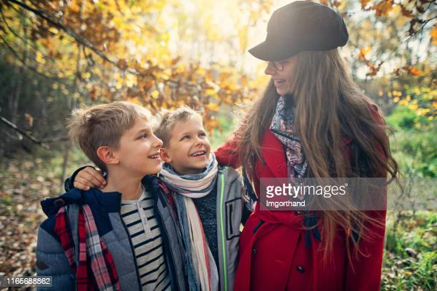 children enjoying autumn forest - imgorthand stock photos and pictures