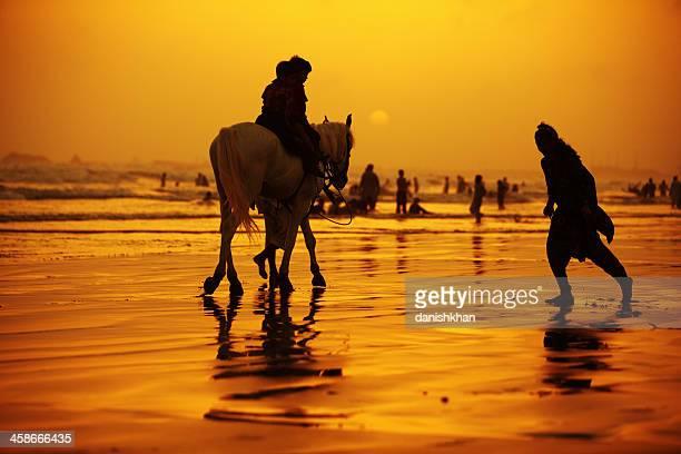 children enjoying horse ride at clifton beach, karachi - pakista - pakistani boys stock photos and pictures