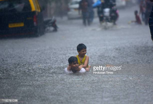 Children enjoying in water logging road at near Guru Kripa Sion on June 28 2019 in Mumbai India Several areas of Mumbai woke up to heavy downpour...