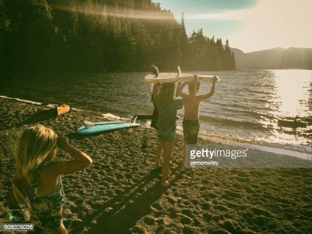 children enjoying last light of summer - lake tahoe stock photos and pictures