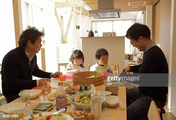 Children enjoying meal with dad us