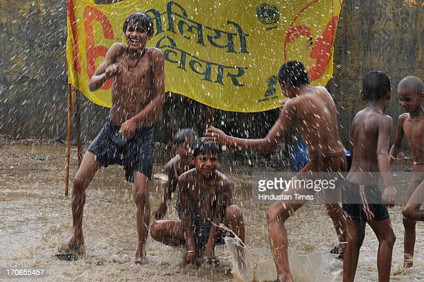 Children enjoying pre-monsoon rain on June 16, 2013 in Noida, India. The national capital has been witnessing pre-monsoon showers, recording 6.1 mm...
