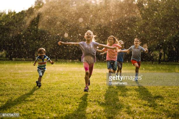 Children enjoying running in the nature