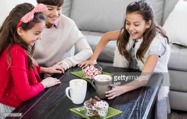 children enjoying winter treat, hot chocolate - mint plant family stock pictures, royalty-free photos & images