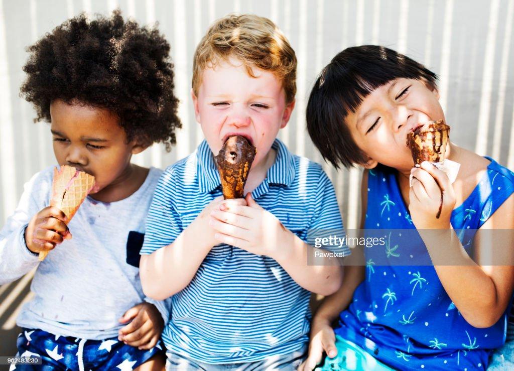 Children enjoying with ice cream : Stock Photo