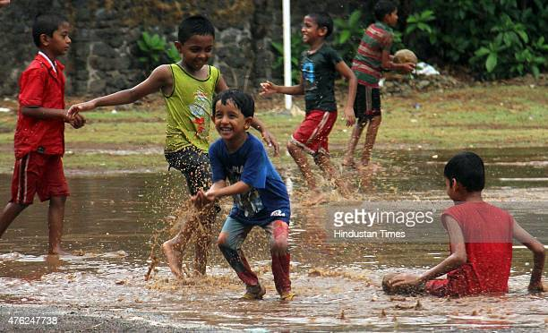 Children enjoys the first monsoon rain at Parel on June 7 2015 in Mumbai India According to Weather bureau from June 8 onwards continuous rain and...