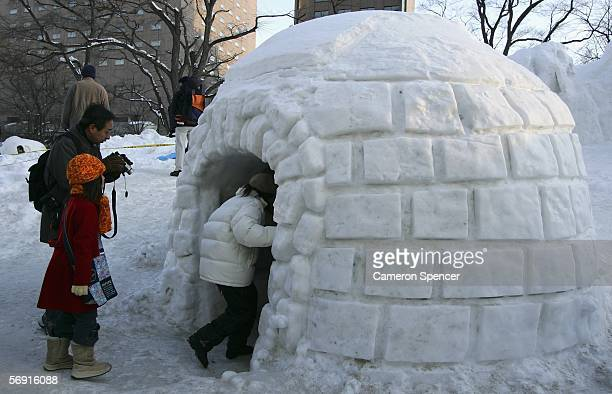 Children enter an igloo during the 57th Sapporo Snow Festival February 12 2006 in Sapporo Hokkaido Japan Two million people are expected to visit the...