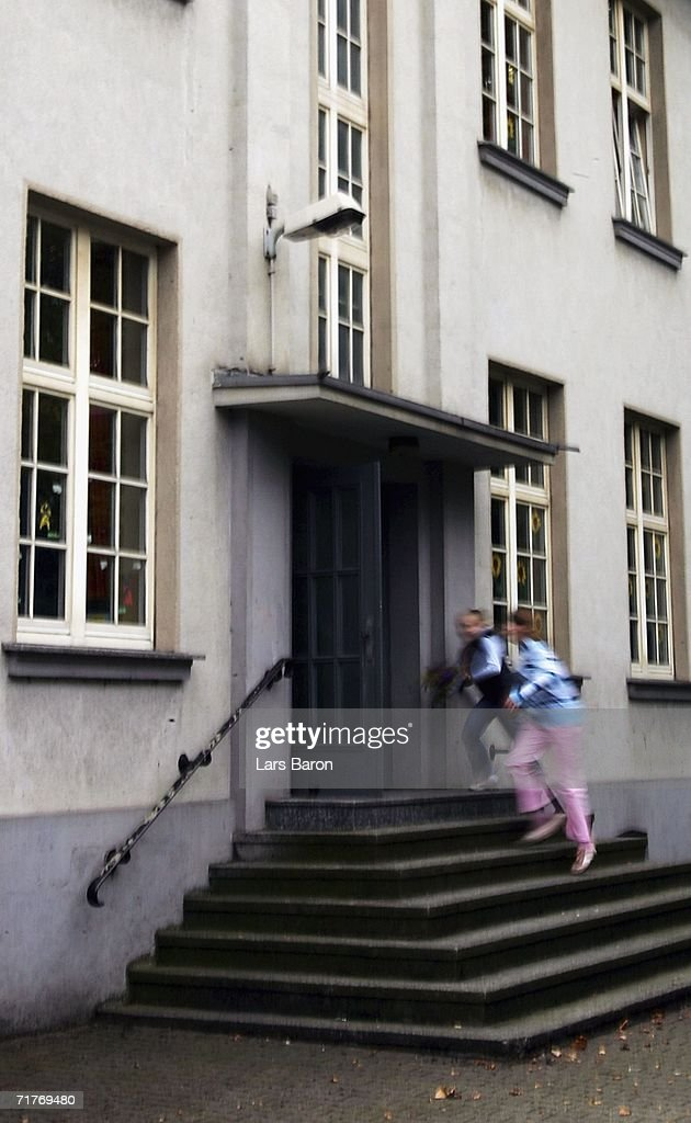 Children enter the elementary school in Duisburg's Dislichstrasse on September 01, 2006, Duisburg-Meiderich, Germany. On the evening of August 31, 2006 a nine year old schoolgirl was wounded as she played in the schoolyard with other pupils, children heard two shoots fired. The police are tracing a suspect, a former teacher living opposite the school.