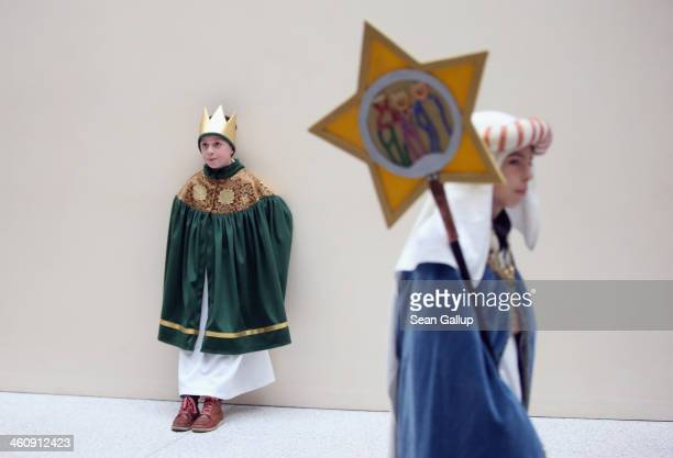 Children Epiphany carolers dressed as the Three Kings prepare to meet with German President Joachim Gauck and his partner Daniela Schadt on January 6...