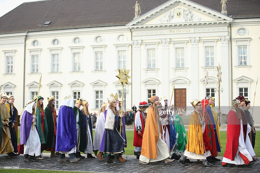 Children Epiphany carolers dressed as the Three Kings walk toward at Schloss Bellevue palace to meet with German President Joachim Gauck and his partner Daniela Schadt on January 6, 2014 in Berlin, Germany. Children, called Sternsinger in German, across Germany dressed as the Three Kings traditionally go from house to house between the end of December and Epiphany to sing and collect donations for cahritable causes.