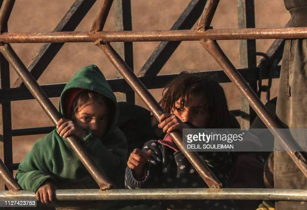 Children evacuated from the Islamic State group's embattled holdout of Baghouz sit in the back of a truck on February 25 2019 during an operation by...