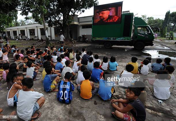 Children evacuees affected by Mayon volcano watch a free movie as part of a program by the local government to entertain evacuees at an evacuation...