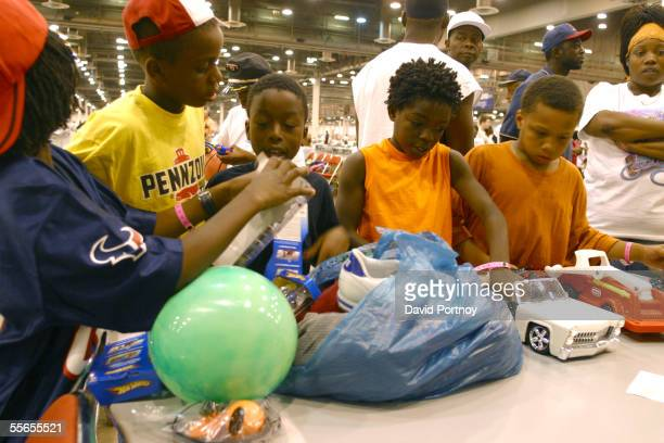 Children evacuees of Hurricane Katrina look at donated toys at a shelter housed inside an exhibition hall in the Astrodome complex in Houston Texas...