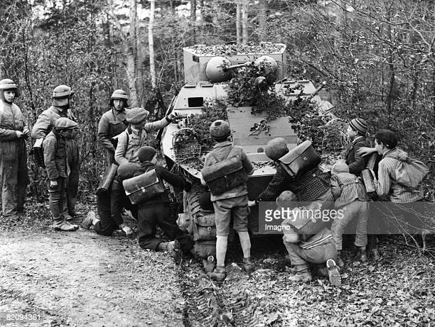 Children examine an armour of the Austrian military Austria Photograph Around 1937 [Kinder begutachten einen Panzer des sterreichischen Militrs...