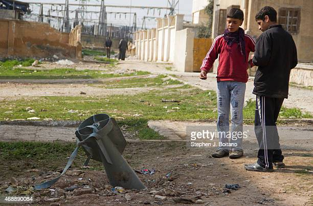 Children examine an unexploded bomb dropped in the Hannano section of Aleppo Six bombs dropped in the area were unexploded