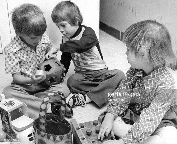 Children Examine Toys They Plan To Swap At Secrest Rca Center From left are Merle Turner Trent Harr and Dione Segeilke Credit Denver Post