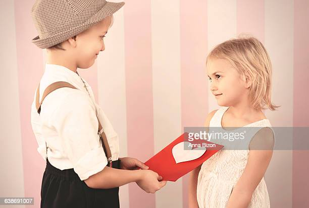 Children exchanging Valentines Day cards. Debica, Poland