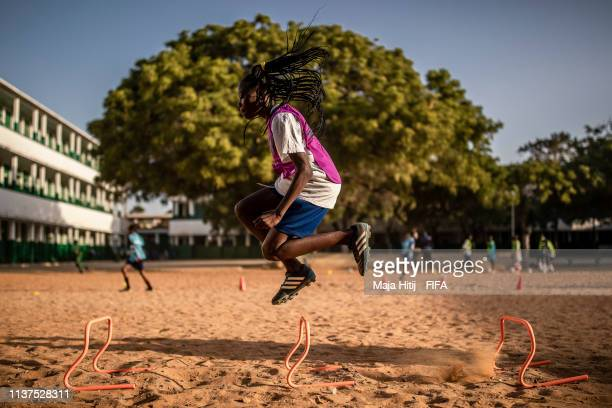 Children exercise during a FIFA Grassroots schools programme on January 15 2019 in Dakar Senegal