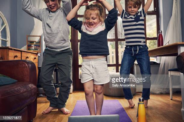 children exercising at home - the internet stock pictures, royalty-free photos & images