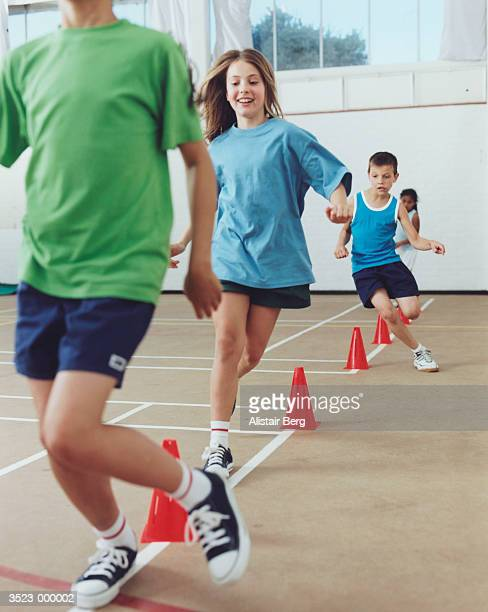 children exercising - physical education stock pictures, royalty-free photos & images
