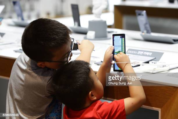 Children experience Samsung Electronics Galaxy Note 8 smartphone at its shop on August 25 2017 in Seoul South Korea Prosecutors are seeking a 12year...
