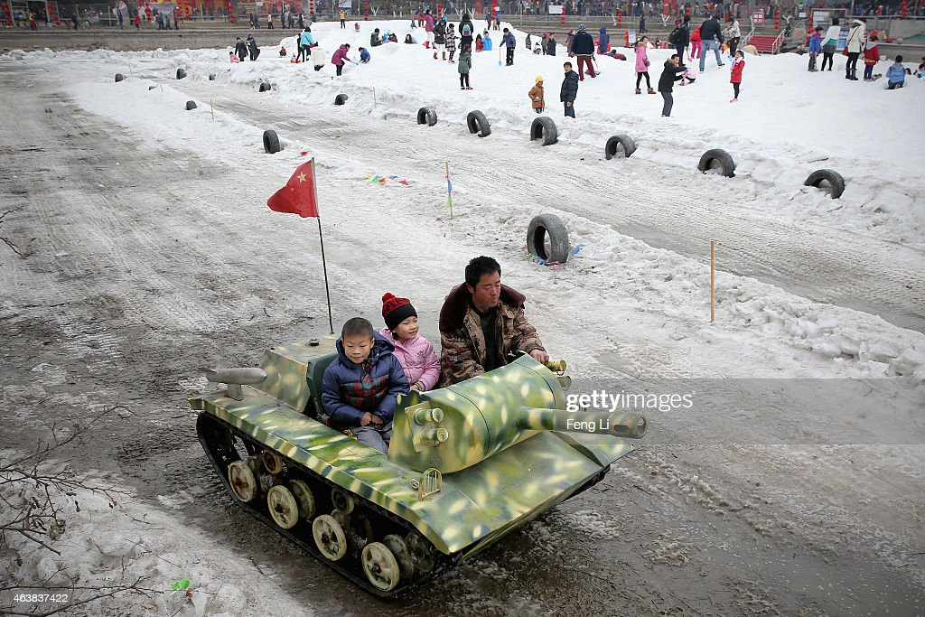 Children experience the mini tank at a temple fair to celebrate the Lunar New Year of Sheep on February 19, 2015 in Beijing, China. The Chinese Lunar New Year of Sheep also known as the Spring Festival, which is based on the Lunisolar Chinese calendar, is celebrated from the first day of the first month of the lunar year and ends with Lantern Festival on the Fifteenth day.