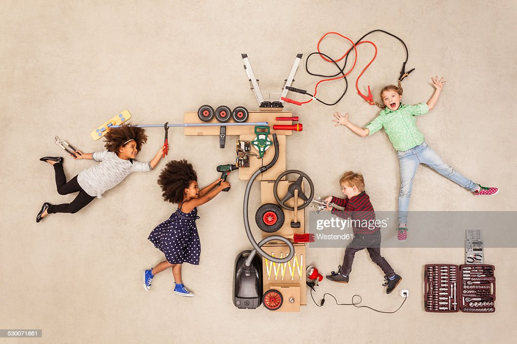 Children experimenting with electricity : Stock Photo