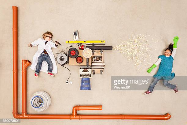 Children experimenting with new household machine