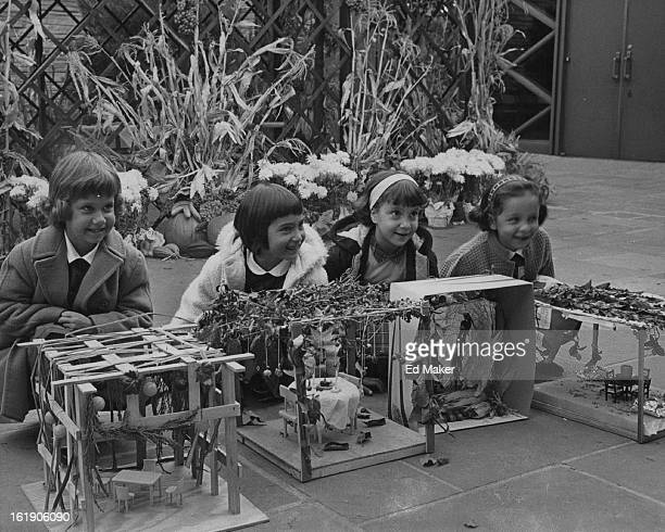 OCT 16 1962 OCT 20 1962 Children Express Thanksgiving in Booths Against a background of harvest bounty four youngsters of the Temple Emanuel...