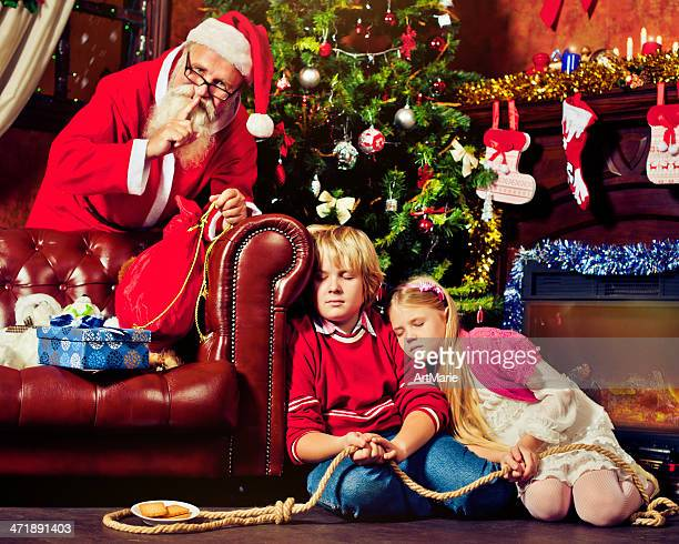 children fallen asleep trying to catch santa claus - naughty santa stock photos and pictures