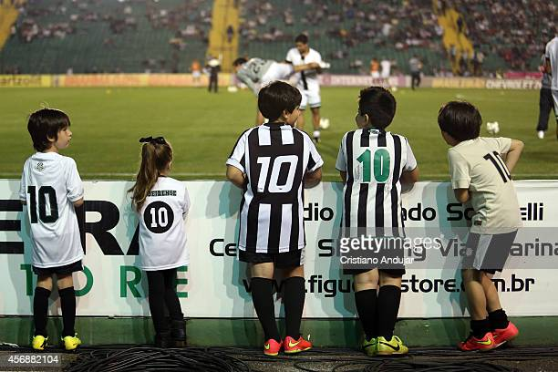 Children fans of Figueirense watch the players of Figueirense warming up prior a match between Figueirense and Flamengo as part of Campeonato...