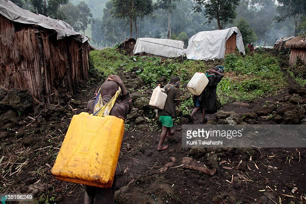 Children fetch water April 25 2010 in the Mungote Internally Displaced Persons camp about 70km north of Goma Democratic Republic of Congo The long...