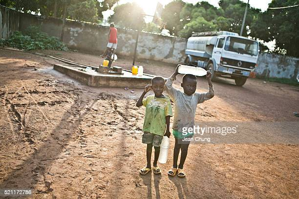 Bangui CENTRAL AFRICAN REPUBLIC October 19 2013 Children fetch water from a Water for Good pump on October 19 2013 in Bangui Central African Republic...