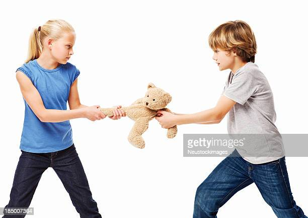Children Fighting Over a Toy Bear - Isolated